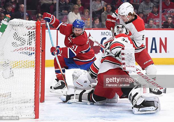 David Desharnais of the Montreal Canadiens takes a shot on goal Cam Ward of the Carolina Hurricanes in the NHL game at the Bell Centre on February 7...