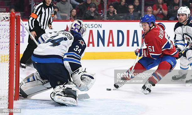 David Desharnais of the Montreal Canadiens takes a shot on Michael Hutchinson the Winnipeg Jets in the NHL game at the Bell Centre on November 1 2015...