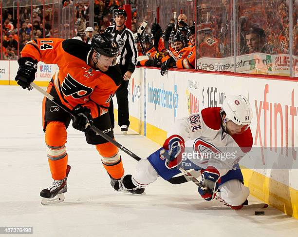 David Desharnais of the Montreal Canadiens tries to keep the puck from Sean Couturier of the Philadelphia Flyers on October 11 2014 at the Wells...