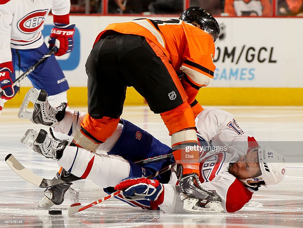 David Desharnais #51 of the Montreal Canadiens tries to stop Claude Giroux #28 of the Philadelphia Flyers from moving forward on October 11, 2014 at the Wells Fargo Center in Philadelphia, Pennsylvania.The Montreal Canadiens defeated the Philadelphia Flyers 4-3 in an overtime shootout.