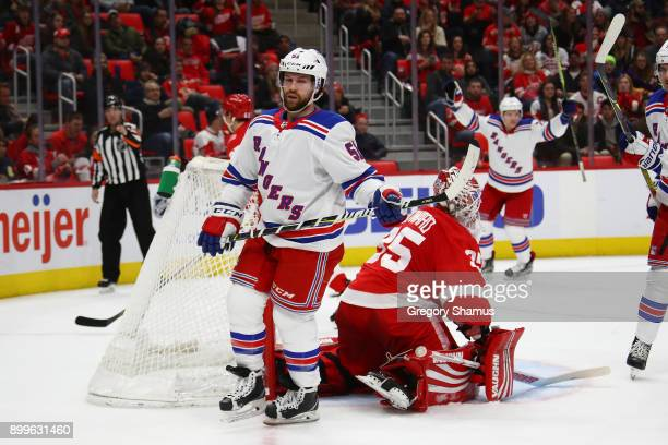 David Desharnais of the New York Rangers celebrates a first period goal in front of Jimmy Howard of the Detroit Red Wings at Little Caesars Arena on...