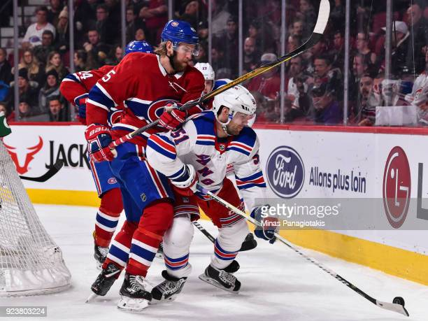 David Desharnais of the New York Rangers defends the puck against Joe Morrow of the Montreal Canadiens during the NHL game at the Bell Centre on...