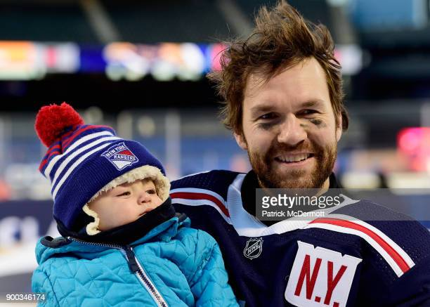 David Desharnais of the New York Rangers hold his baby after his team defeated the Buffalo Sabres 32 in overtime of the 2018 Bridgestone NHL Winter...