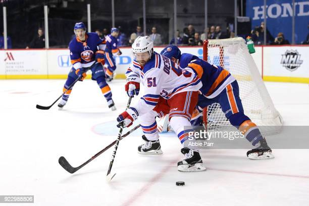 David Desharnais of the New York Rangers reaches for the puck against the New York Islanders in the first period during their game at Barclays Center...