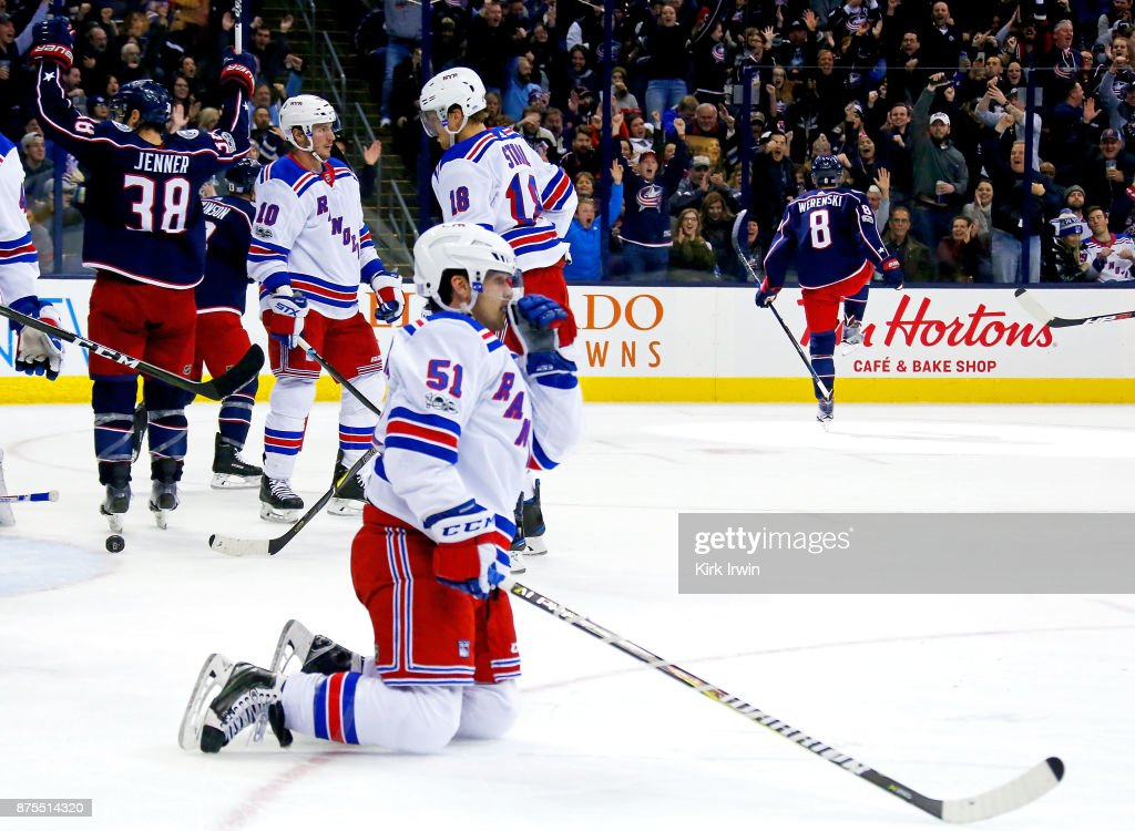 David Desharnais #51 of the New York Rangers reacts to his team giving up a goal as Boone Jenner #38 of the Columbus Blue Jackets and Zach Werenski #8 of the Columbus Blue Jackets celebrate Werenski's goal during the second period on November 17, 2017 at Nationwide Arena in Columbus, Ohio.