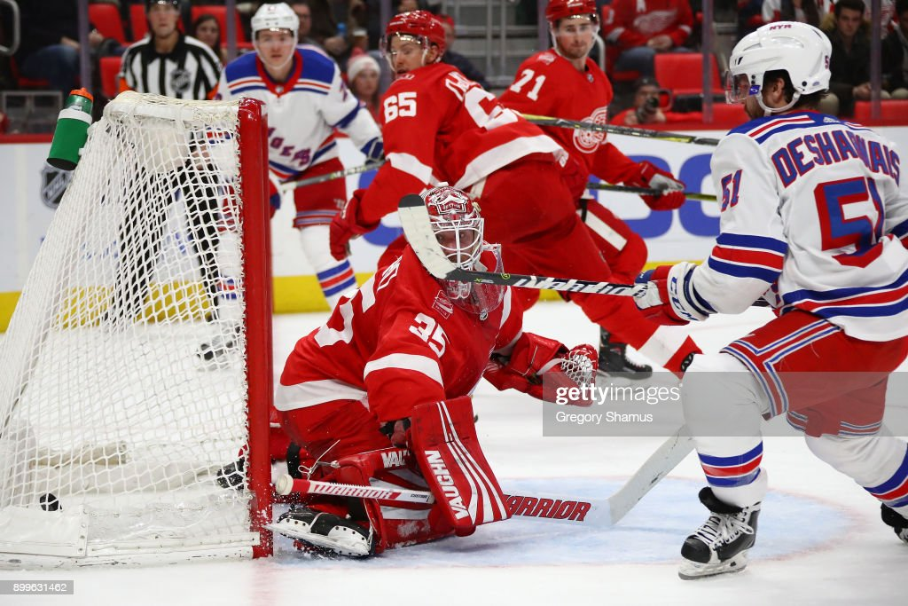 David Desharnais #51 of the New York Rangers scores a first period goal past Jimmy Howard #35 of the Detroit Red Wings at Little Caesars Arena on December 29, 2017 in Detroit, Michigan.