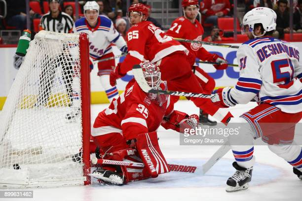 David Desharnais of the New York Rangers scores a first period goal past Jimmy Howard of the Detroit Red Wings at Little Caesars Arena on December 29...