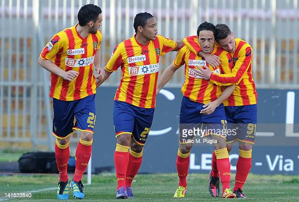 David Di Michele celebrates with teammates after scoring a penalty during the Serie A match between US Lecce and US Citta di Palermo at Stadio Via...