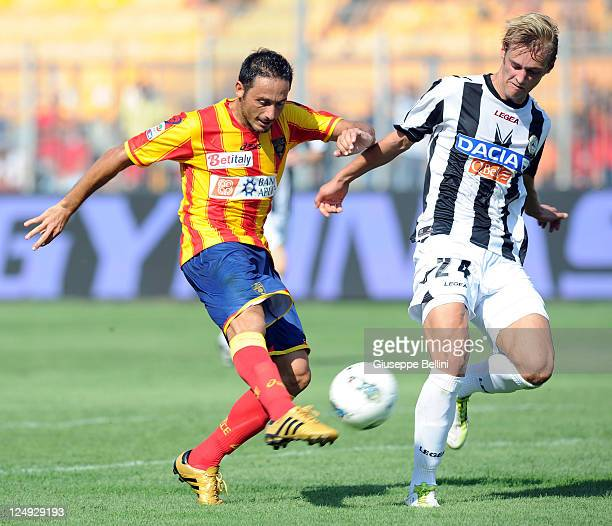 David Di Michele of Lecce is challenged by Joel Ekstrand of Udinese during the Serie A match between US Lecce and Udinese Calcio at Stadio Via del...