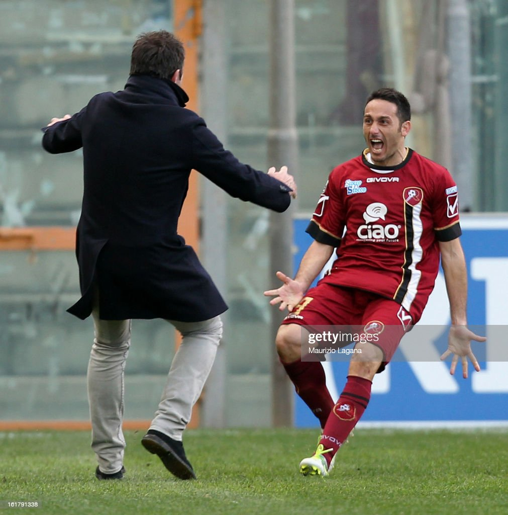 David Di Michele of Reggina celebrates the winning goal with his coach Davide Dionigi during the Serie B match between Reggina Calcio and Calcio Padova on February 16, 2013 in Reggio Calabria, Italy.