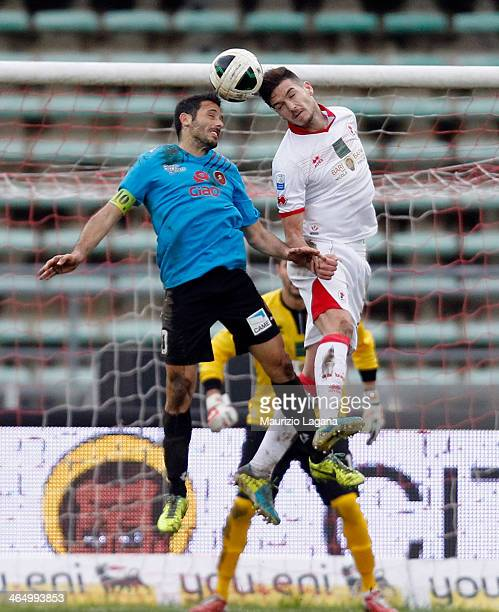 David Di Michele of Reggina competes for the ball in air with Luca Cappitelli of Bari during the Serie B match between AS Bari and Reggina Calcio at...