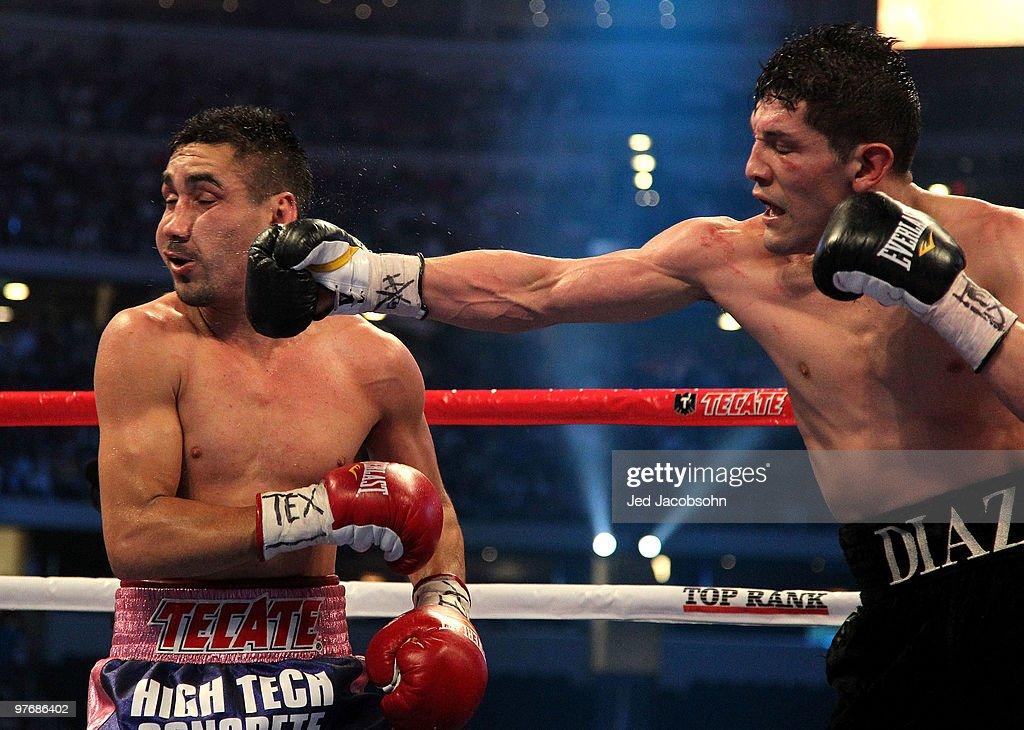David Diaz connects with a right to the face of Humberto Soto of Mexico during the WBC lightweight title fight at Cowboys Stadium on March 13, 2010 in Arlington, Texas.