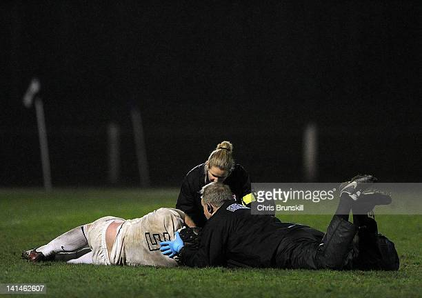 David Dickinson of England receives treatment during the match between England Counties and Ulster Bank International Team at Lightfoot Green on...