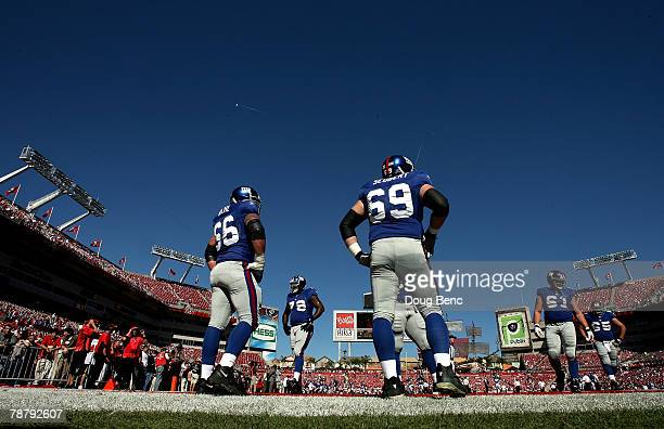David Diehl and Rich Seubert of the New York Giants wait on the field before playing in the NFC Wild Card game against Tampa Bay Buccaneers at...