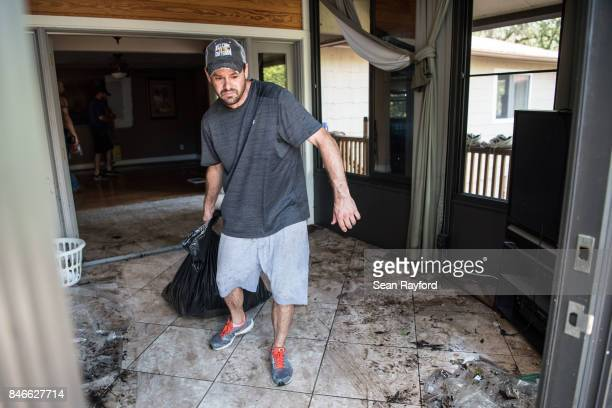 David Dionne helps to clean up as floodwaters from Hurricane Irma recede September 13 2017 in Middleburg Florida Floodwaters in town from the Black...