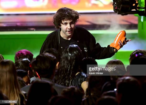 David Dobrik accepts the Favorite Social Star award onstage at Nickelodeon's 2019 Kids' Choice Awards at Galen Center on March 23 2019 in Los Angeles...