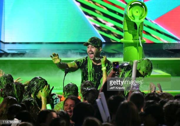 David Dobrik and Josh Peck get slimed onstage at Nickelodeon's 2019 Kids' Choice Awards at Galen Center on March 23 2019 in Los Angeles California