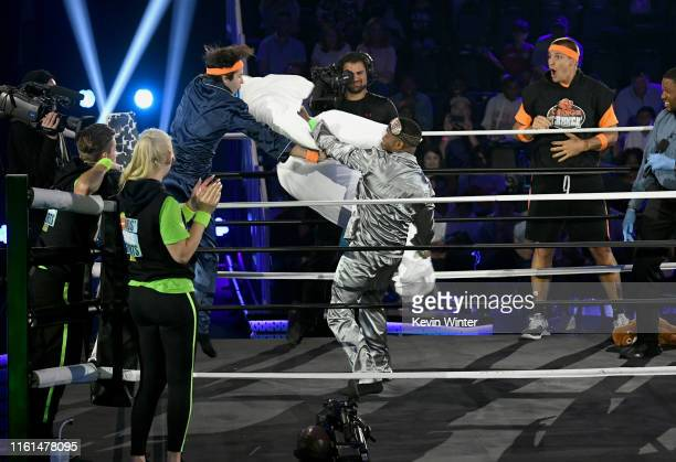 David Dobrik Kel Mitchell and Rob Gronkowski participate in a challenge onstage during Nickelodeon Kids' Choice Sports 2019 at Barker Hangar on July...