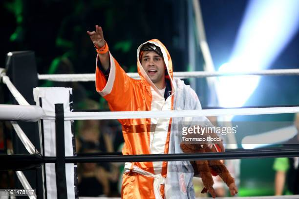 David Dobrik participates in a challenge onstage during Nickelodeon Kids' Choice Sports 2019 at Barker Hangar on July 11 2019 in Santa Monica...