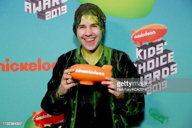 David Dobrik poses with award at Nickelodeon's 2019 Kids' Choice Awards at Galen Center on March 23 2019 in Los Angeles California