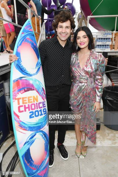 David Dobrik winner of Choice Male Web Star poses with cohost Lucy Hale during FOX's Teen Choice Awards 2019 on August 11 2019 in Hermosa Beach...