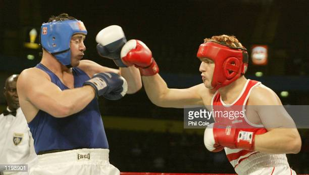 David Dolan of England in action on his way to victory over Kevin Evans of Wales in the Men's Super Heavyweight semi final at the MEN Arena during...