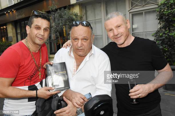 David Donadei from Citestars Franck Tiozzo and Jo Prestia attend Jamais A Terre Jo Prestia Book Signing At Art Cube Galerie on July 7 2018 in Paris...