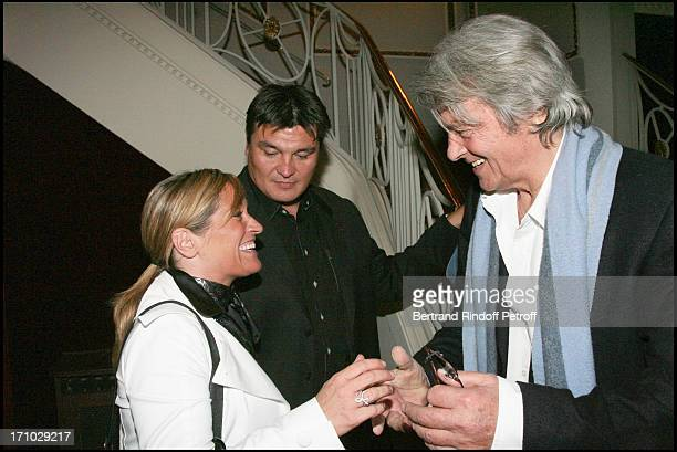 David Douillet and his wife Valerie and Alain Delon Surprise birthday of Mireille Darc on the stage of the Marigny theater by Alain Delon at the end...