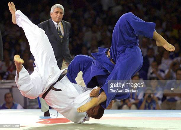 David Douillet of France and Shinichi Shinohara of Japan compete in the Men's Judo 100kg gold medal match during the Sydney Olympics at the Sydney...