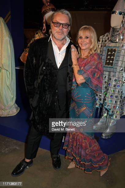 David Downton and Britt Ekland attend a private view of Zandra Rhodes 50 Years Of Fabulous at The Fashion and Textile Museum on September 26 2019 in...