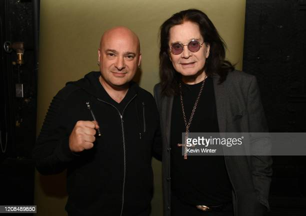 David Draiman and Ozzy Osbourne pose backstage during iHeartRadio ICONS with Ozzy Osbourne: In Celebration of Ordinary Man at iHeartRadio Theater on...