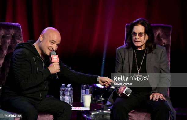 David Draiman and Ozzy Osbourne speak onstage at iHeartRadio ICONS with Ozzy Osbourne: In Celebration of Ordinary Man at iHeartRadio Theater on...