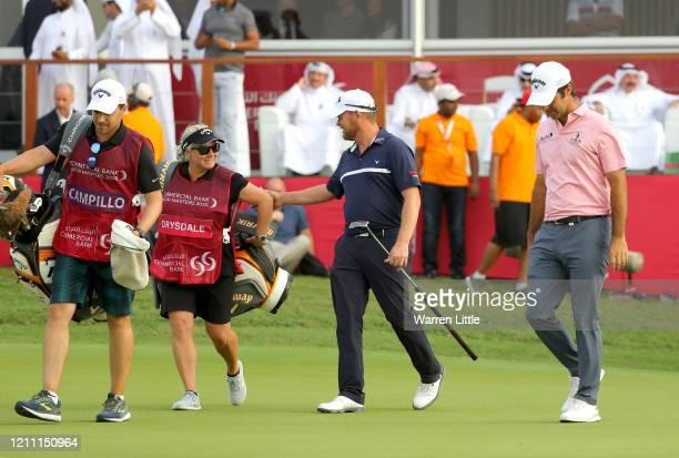 David Drysdale of Scotland and Jorge Campillo of Spain react after both making birdie and forcing a third play off hole during Day 4 of the...