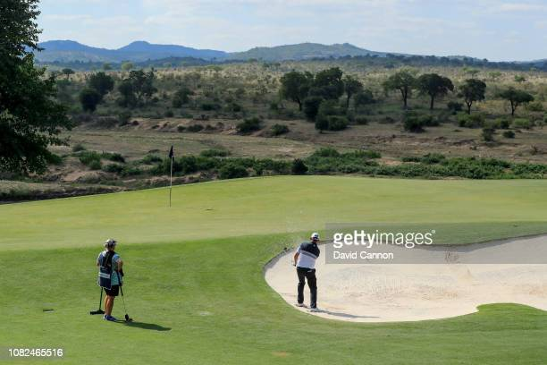 David Drysdale of Scotland plays his third shot on the par 5 13th hole with the Kruger National Park behind the green during the second round of the...