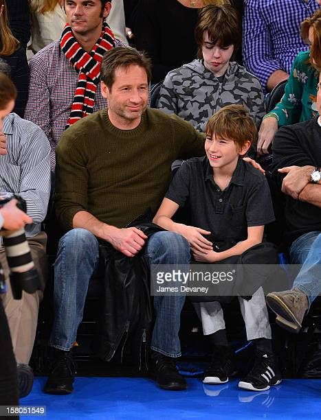 David Duchovny and Kyd Miller Duchovny attend the Denver Nuggets vs New York Knicks game at Madison Square Garden on December 9 2012 in New York City