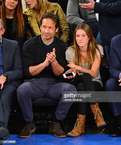 David Duchovny and Madelaine Duchovny attend the Boston Celtics vs New York Knicks game at Madison Square Garden on January 7 2013 in New York City