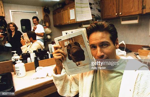 David Duchovny costar of cult TV series The XFiles posing in dressing room on the set of the show
