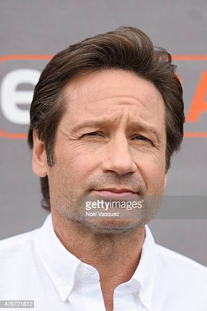 David Duchovny visits 'Extra' at Universal Studios Hollywood on June 11 2015 in Universal City California