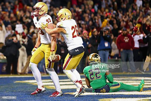David Dudeck of the Boston College Eagles congratulates Charlie Callinan after he scored a touchdown during the second half against the Notre Dame...