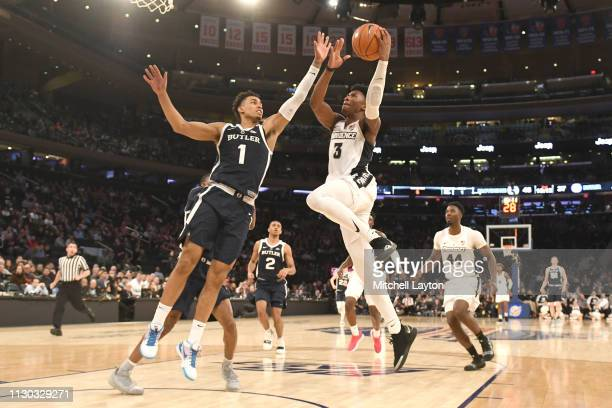 David Duke of the Providence Friars takes a shot over Jordan Tucker of the Butler Bulldogs in the second half during the Big East Conference...