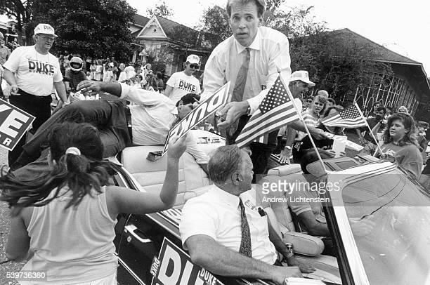 David Duke's bodyguard reaches for a gun as Duke's motorcade approaches a part of town where mostly African Americans live David Duke a former Klu...