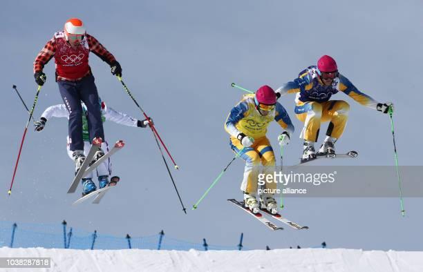David Duncan of Canada Arnaud Bovolenta of France John Eklund of Sweden Michael Forslund of Sweden compete in the Men's Freestyle Skiing Ski Cross...