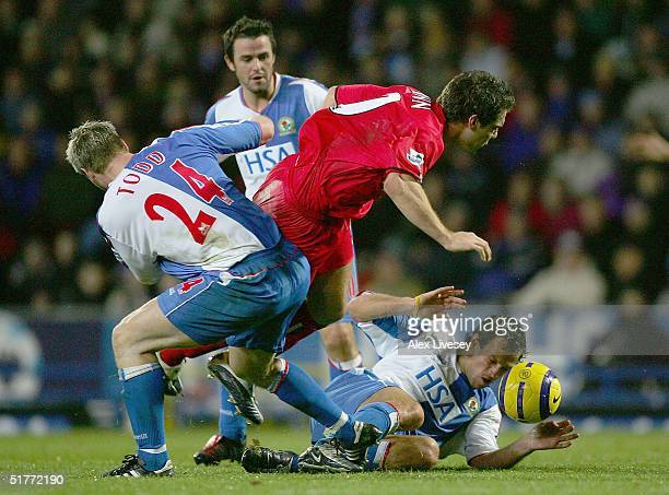 David Dunn of Birmingham City is tackled by Andy Todd and Lucas Neill of Blackburn Rovers during the Barclays Premiership match between Blackburn...
