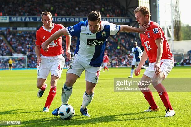 David Dunn of Blackburn holds back Sebastian Larsson of Birmingham City during the Barclays Premier League match between Blackburn Rovers and...