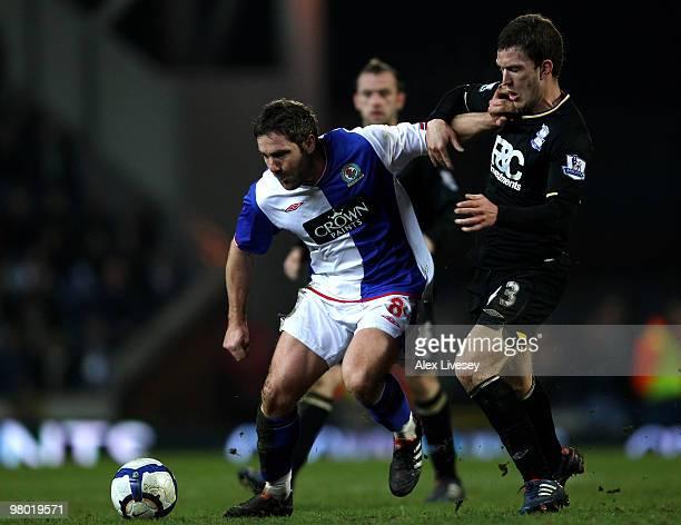 David Dunn of Blackburn Rovers holds off the challenge of Craig Gardner of Birmingham City during the Barclays Premier League match between Blackburn...