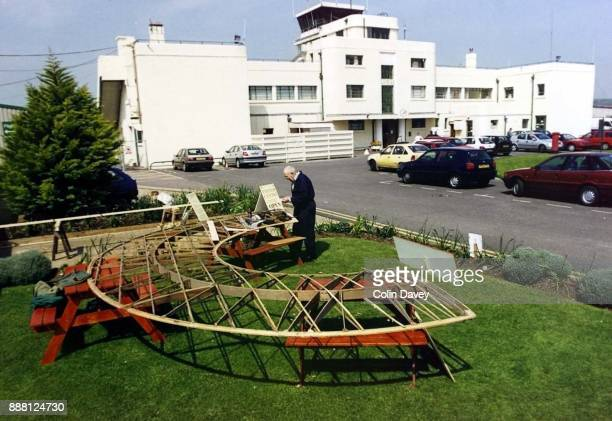 David Dunstall poses with a replica of an unusual circular winged LeeRichards annular biplane at Shoreham Airport UK 30th August 2000
