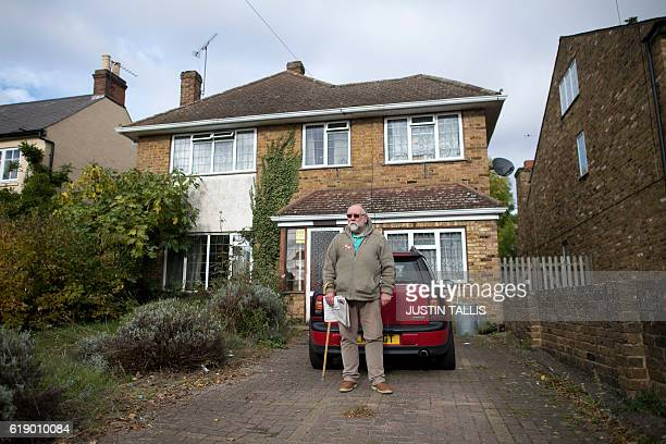 David Durston who has lived in his home on the High Street since 1983 poses for a portrait outside his home which would be on the cliff edge of the...