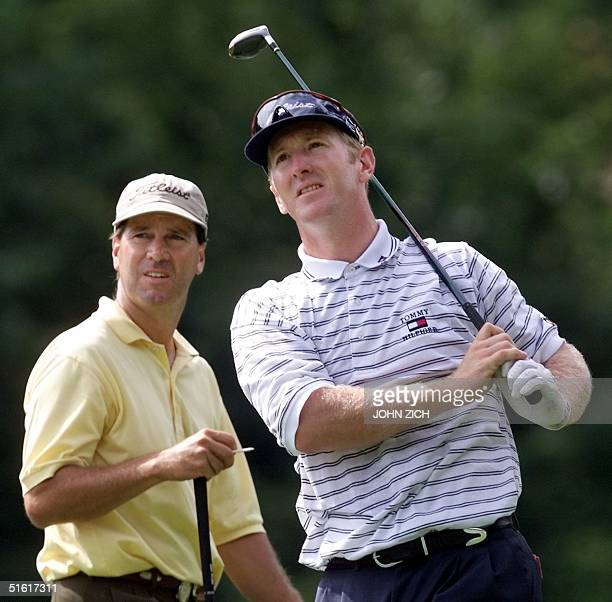 David Duval and club pro Wayne DeFrancesco , both of the US, watch Duval's tee shot on the 16th tee 11 August 1999 during the final practice round...
