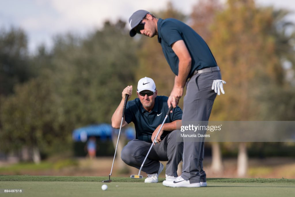 David Duval and Nick Karavites track a putt on the 18th green during the final round of the PNC Father/Son Challenge at The Ritz-Carlton Golf Club on December 17, 2017 in Orlando, Florida.