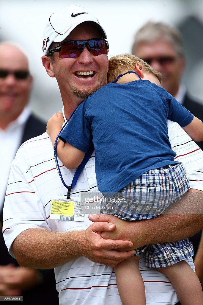 David Duval smiles while holding his two year old son Brayden during the trophy presentation after the final round of the 109th U.S. Open on the Black Course at Bethpage State Park on June 22, 2009 in Farmingdale, New York.